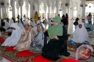Warsi in a Mosque in Indonesia where she had gone to see the reconstruction after the tsunami.