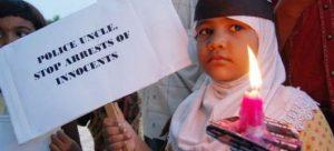 A-girl-protests-against-arrests-of-innocent